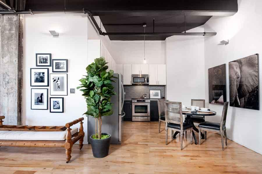 Open Kitchen and Dining Area at Rocket Factory Lofts in Williamsburg