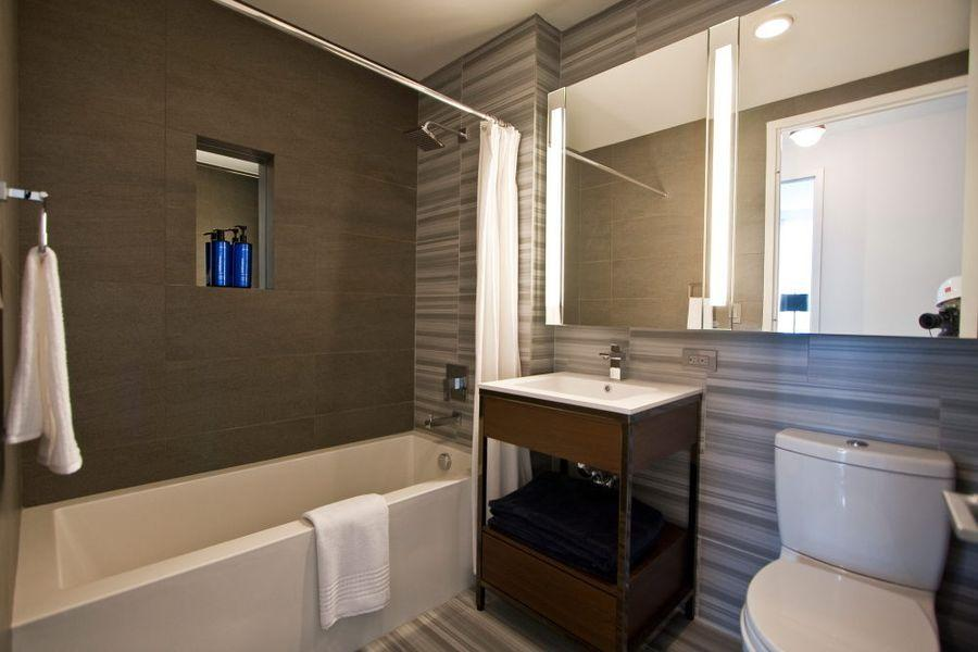 Bathroom at 555 Tenth Avenue in Clinton - Apartments for rent