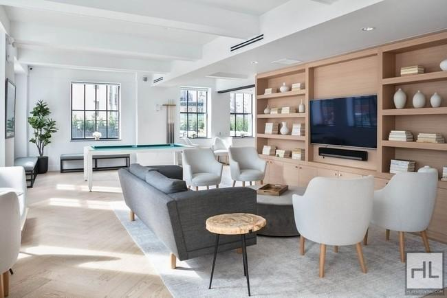 Living and dining area at 67 Wall Street - NYC Apartments for rent