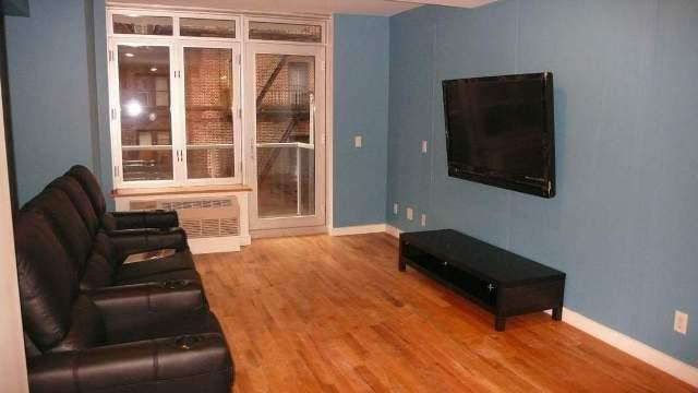 The Stanton Living Room - Manhattan Apartments for rent