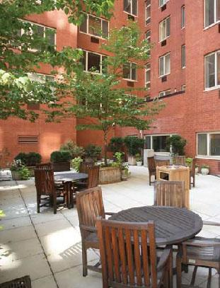 The Saranac rental building Sun Deck - NYC Flats