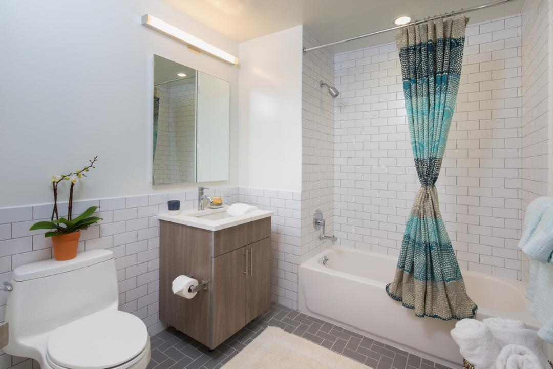 Bathroom at Eleven 33 - 1133 Manhattan Ave apartments for rent