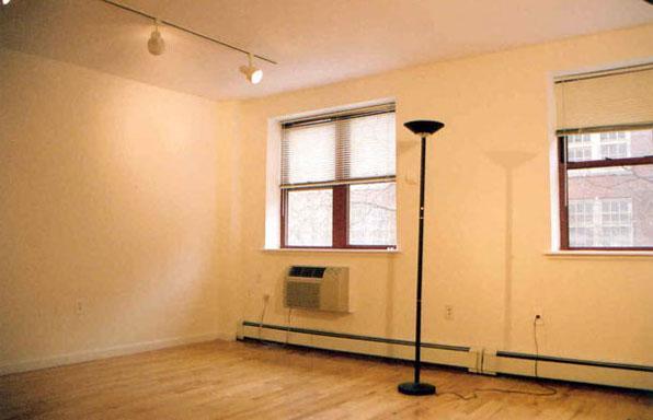 Tompkins Square Plaza rental building Living Room – NYC Flats