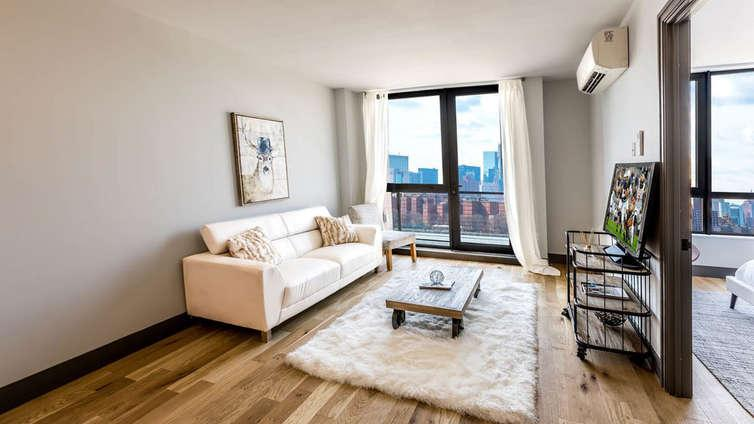 Living room at 26 West Street - NYC Apartments for rent