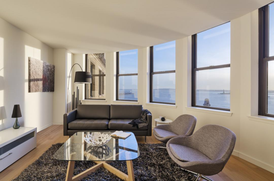 Livingroom at 1 West Street in Manhattan - Condos for rent