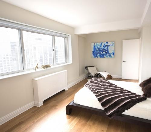 Bedroom at Stonehenge 65 in NYC - Apartments for rent