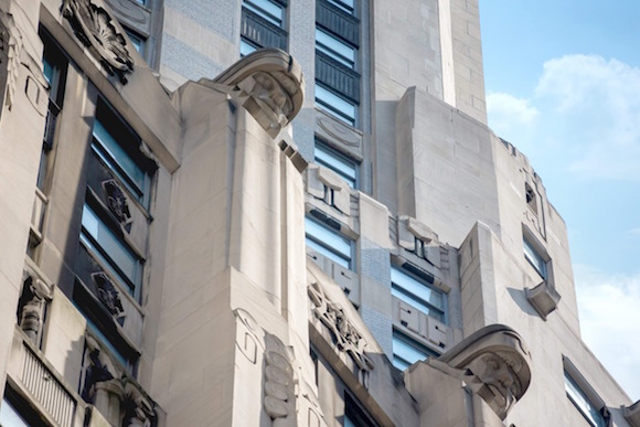 Facade of 20 Exchange Place, displaying Art Deco ornaments and design.