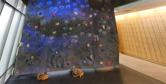 The rock climbing wall at the 10 Hanover Square Rental Apartments